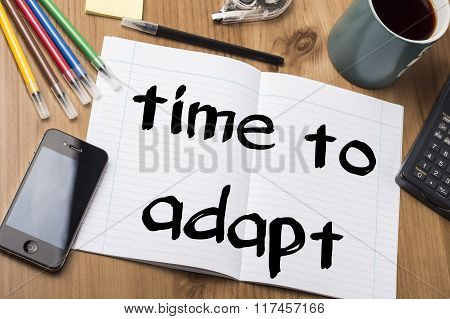 Time To Adapt - Note Pad With Text On Wooden Table