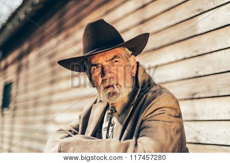 Old Man Smoking A Cigarette While Looking Afar