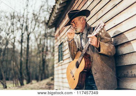 Senior Male Musician Smoking A Cigarette