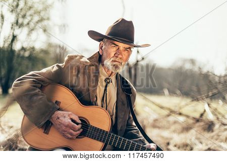 Serious Elderly Country And Western Guitarist