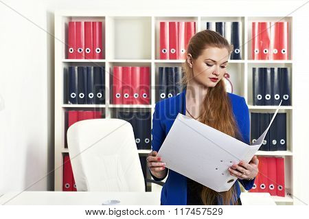 Young woman  holding paper documents