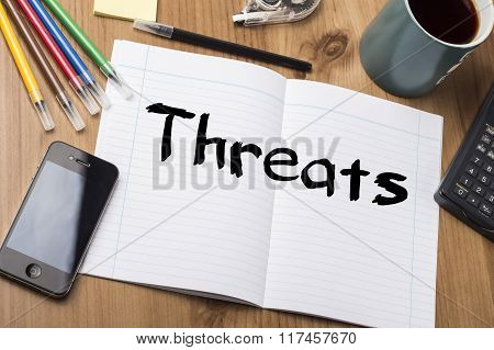 Threats - Note Pad With Text On Wooden Table