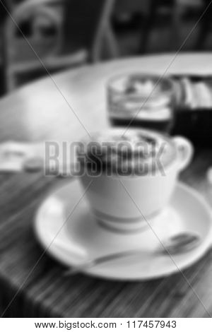 A Cup Of Coffee In Coffee Shop. In Blur Style. In Black And White. Retro Style