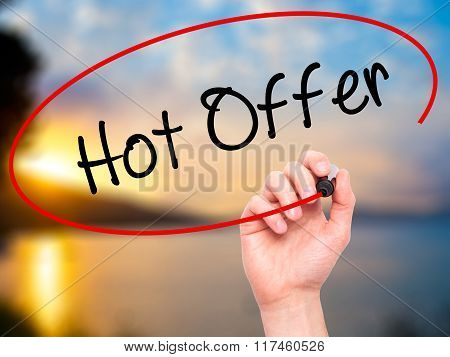 Man Hand Writing Hot Offer With Black Marker On Visual Screen.