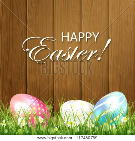 Wooden Easter Background With Three Colorful Eggs