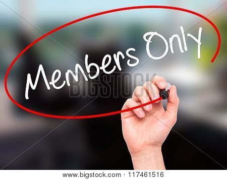 Man Hand Writing Members Only With Black Marker On Visual Screen.