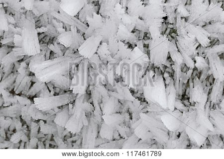 Ice crystals forming on the ground surface in the morning during winter time