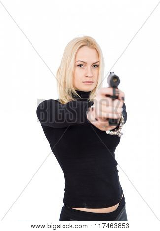 blonde girl in a black suit with gun aiming at camera