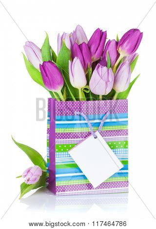 Purple tulip bouquet in gift bag. Isolated on white background