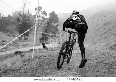 Cyclocross Rider Mounts Bike