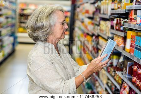 Senior woman buying food at the supermarket