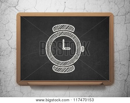 Time concept: Watch on chalkboard background