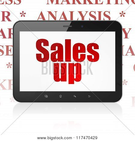 Advertising concept: Tablet Computer with Sales Up on display