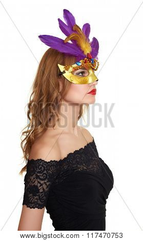 Young woman portrait in black evening gown on white. Carnival mask on face.