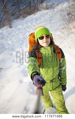 Girl In Winter Clothes Makes A Self-portrait.