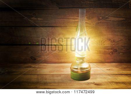 Old kerosene lamp on wooden table