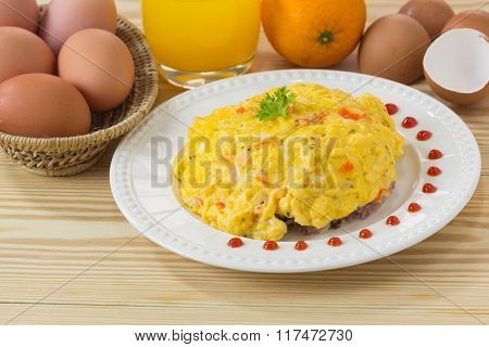Selective Focus Of Scrambled Egg With Crab Stick On Wood Background