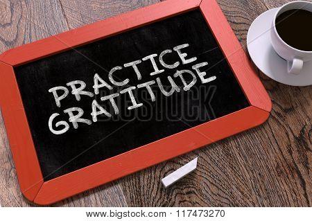 Practice Gratitude Handwritten on Chalkboard.