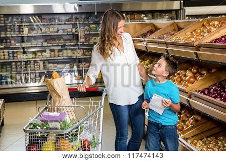 Mother and son looking at each other in grocery store