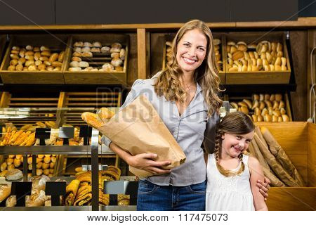 Portrait of mother and daughter in grocery store
