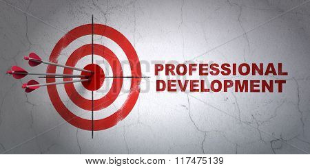 Studying concept: target and Professional Development on wall background