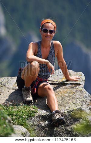 young woman tourist in alpine zone in summer in summer