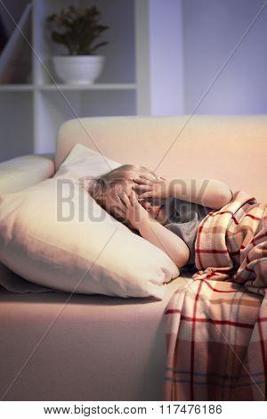 boy hide face play slip on sofa