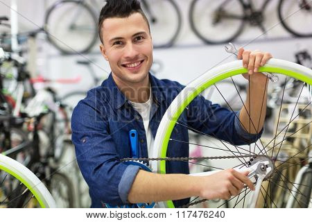 Man working in bicycle repair shop