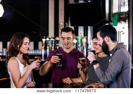 Friends having a pint in a bar