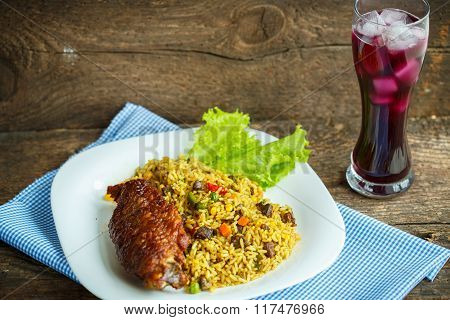 Tasty Dishes From Turkey Meat With Rice And Salad Leaves And A Glass Of Juice With Ice