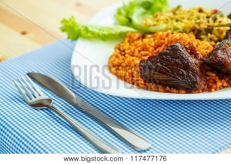 Tasty Dish Of Roast Beef With Rice And Salad Leaves