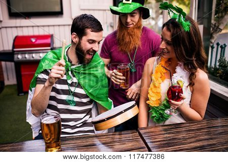 Friends celebrating St Patricks day with cocktails