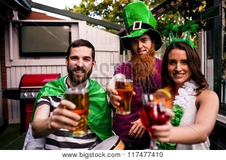 Friends celebrating St Patricks day with drinks