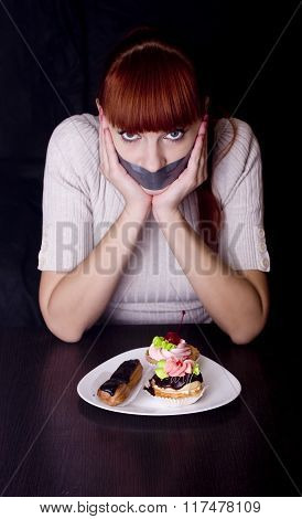 Girl With Her Mouth Sealed With Adhesive Tape And Cakes