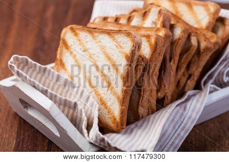 toasted bread, on a wooden