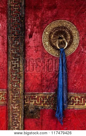 Gate of Spituk Gompa (Tibetan Buddhist monastery) with ornamented decorated door handle. Ladakh, India