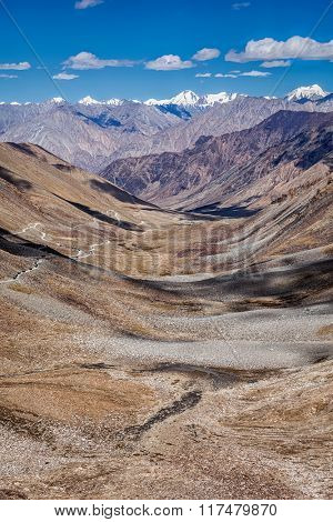 View of Karakorum range and road in valley  from Kardung La - the highest motorable pass in the world (5602 m). Ladakh, India