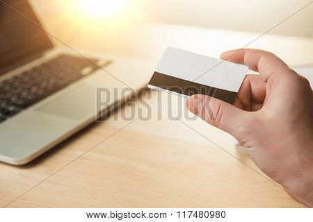 The man doing online shopping with credit card