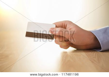 The male hand showing credit card