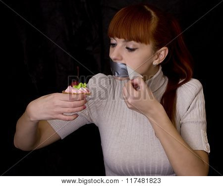 Girl With Her Mouth Sealed With Adhesive Tape And Cake