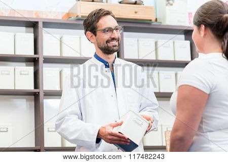 Woman shopping alternative drugs at herbalist