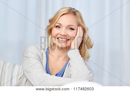 people and leisure concept - happy middle aged woman at home