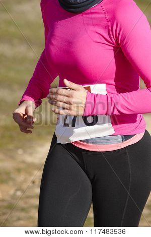 Female Athletic Runner On A Race. Outdoor Circuit