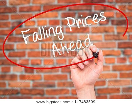 Man Hand Writing Falling Prices Ahead With Black Marker On Visual Screen