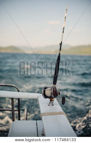 Reel Fishing Rod In Chrome Holder On Boat