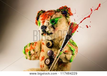 Bear Toy As An Artist Holding A Paintbrush