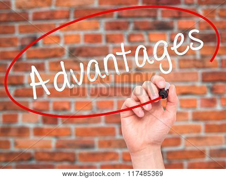 Man Hand Writing Advantages With Black Marker On Visual Screen