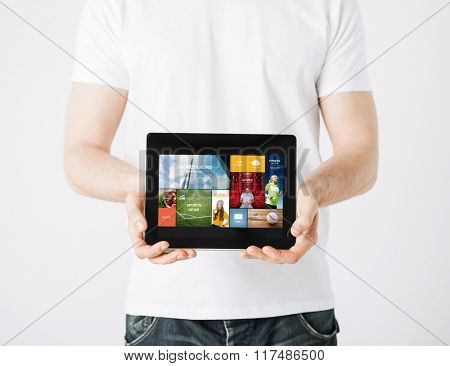 people, technology, mass media and internet concept - close up of man with tablet pc computer and web pages