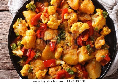 Indian Food: Gobi Aloo Close-up On The Table. Horizontal Top View