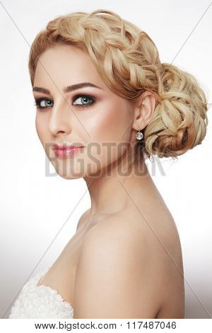 Young beautiful blonde woman with stylish make-up and fancy prom hairdo